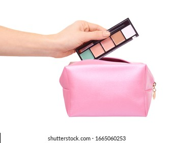 Hand with pink makeup bag. Glamour cosmetic accessory. Isolated on white background.
