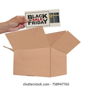 Hand placing Black Friday Sale paper in open cardboard box white background