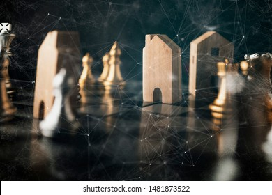 hand play chess and house model business financial home load insurance ideas concept
