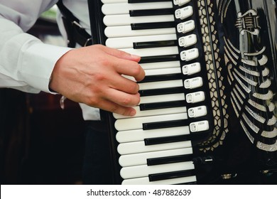 Hand playing accordions closeup