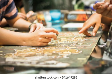 Hand playing board game, strategy concept.