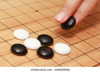 hand playing go a strategicboard  game