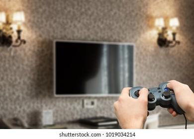 Hand playing on joystick