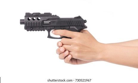 hand playing with a toy gun isolated on white background