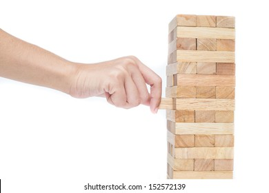 Hand playing with the wood game (jenga). on white background.