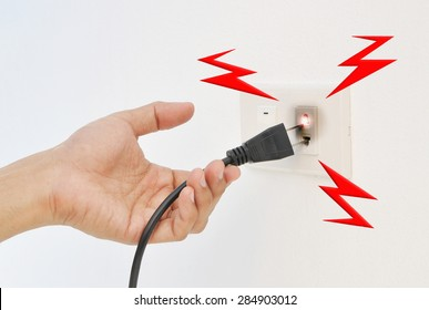 Hand and Plug Electricity shock