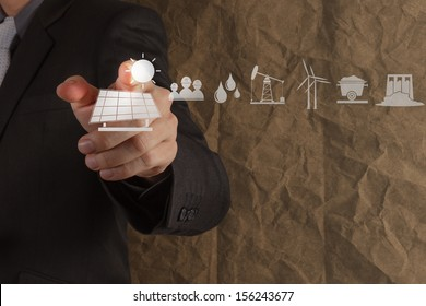 hand point solar cell icon with crumpled recycle paper background as concept