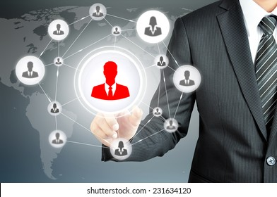 Hand pointing to businessman icon in the middle that linked with each other as network - HR,HRM,HRD, teamwork & leadership concept