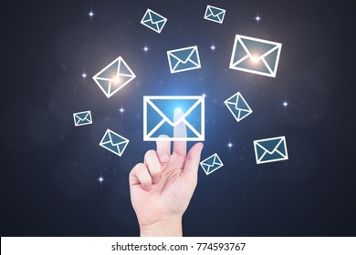 Hand pointing at e-mail network. Dark blurry background. Email networking concept. 3D Rendering