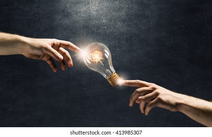 Hand pointing light bulb