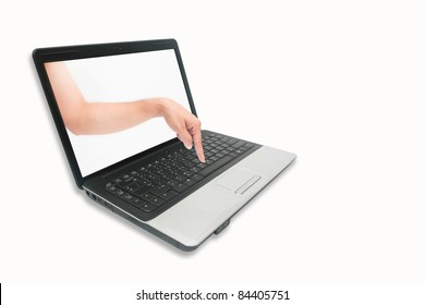 A hand is pointing through a notebook