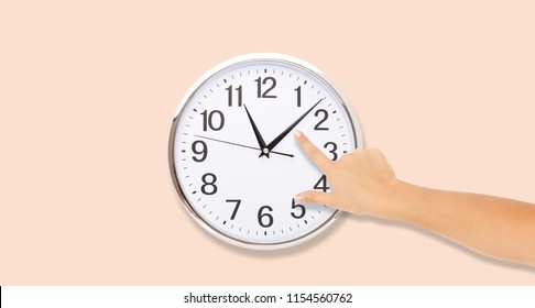 The hand points to the arrows in the clock. Time Punctual Second Minute Hour Concept