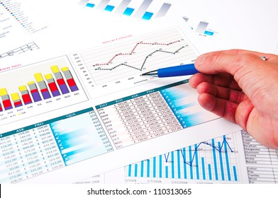 hand points to the growth charts, a picture describing the success of business