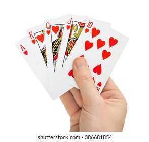 Hand with poker cards isolated on white background