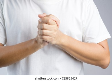 Hand with praying sign or gesture in christian religion on white background