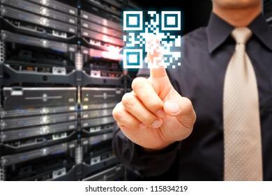 Hand press on QR code in server room
