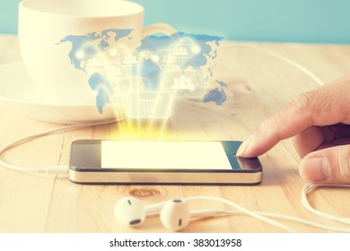 Hand press smart phone with coffee cup and earphone,concept everything can do on your hand by smart phone,vintage filter