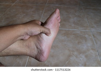 Hand pressed foot Due to pain, Foot pain, health concept.