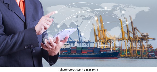 hand presses on world map with digital tablet,Industrial Container Cargo freight ship at dusk for Logistic Import Export background (Elements of this image furnished by NASA)