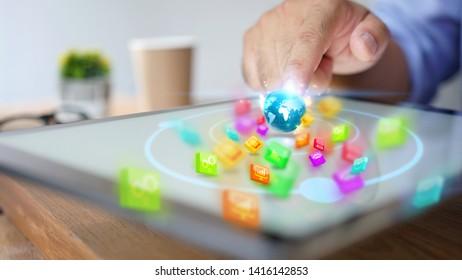 hand presses social media icons on screen digital tablet