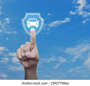 Hand pressing car with shield flat icon over blue sky with white clouds, Business automobile insurance concept