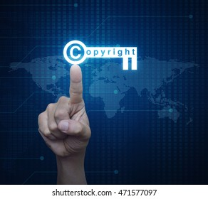 Hand pressing copyright key icon over digital world map technology style, Copyright and patents concept, Elements of this image furnished by NASA