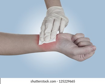 Hand pressing gauze on arm after administering an injection. Healthcare And Medicine Concept photo. Colour enhanced skin to emphasize problematic part.