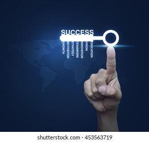 Hand pressing key with business words over digital world map blue background, Success concept, Elements of this image furnished by NASA