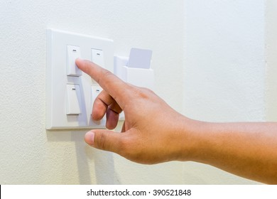 Hand pressing light switch