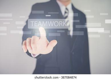 Hand pressing modern multimedia teamwork type buttons on network concept structure,Businessman