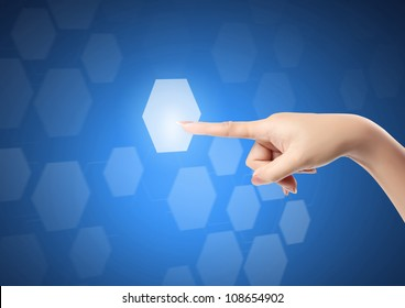 hand pressing a touchscreen button