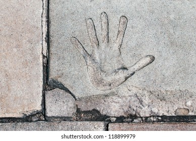 Hand Print - A hand print in cracked cement