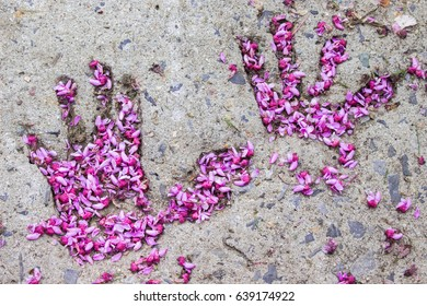Hand print filled with flower petals