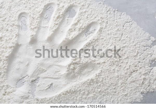 Hand print on flour