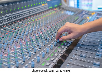 Hand of the professional audio musical mixer