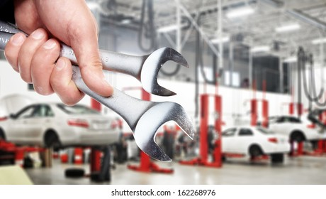 Hand of professional Auto mechanic with wrench.