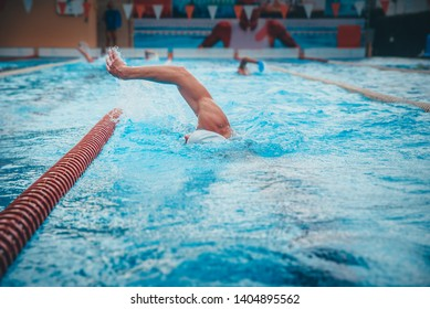Hand of professional swimmer in swimming pool.