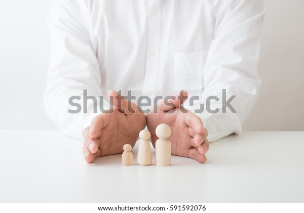 hand protecting family