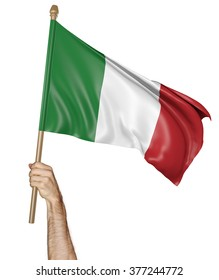 Hand proudly waving the national flag of Italy