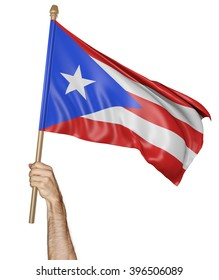 Hand proudly waving the national flag of Puerto Rico