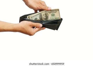 Hand pulling cash from the black leather wallet isolated on white background
