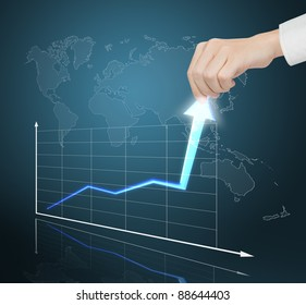 hand pulling financial business graph to high growth rate