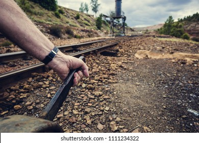 hand pulling the lever to change the way in the old train station of Zaranda, Spain