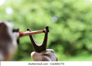 Hand pulling slingshot