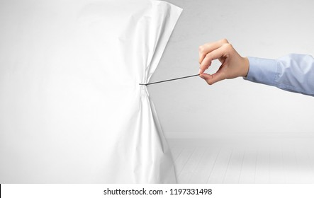 hand pulling white paper curtain, changing scene concept
