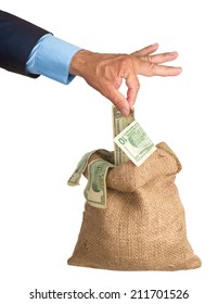 Hand pulls money out of the bag. isolated. eries of images.