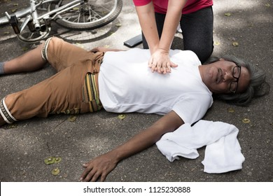 hand pump on chest of Asian patient man, unconscious patient treatment, cardiopulmonary resuscitation, cpr, heart attack, Acute myocardial infarction