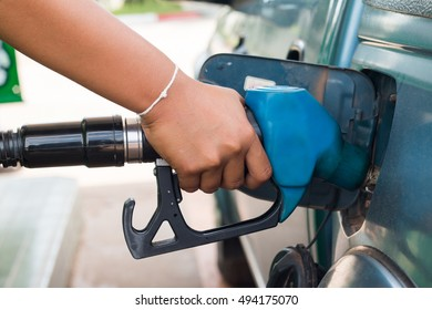 Hand Pumping Gas Into Car.