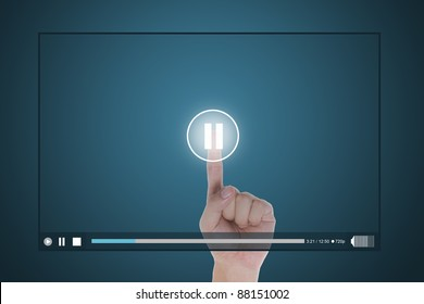 hand push pause button on touch screen to suspend video clip