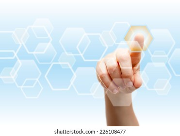 hand pushing a button on a touch screen in a scientific or medical environment.